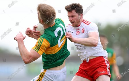 Stock Photo of Tyrone vs Kerry. Tyrone's Rory Brennan catches Tommy Walsh of Kerry