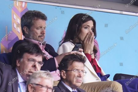Crown Prince Frederik (L) and Crown Princess Mary of Denmark react as Christian Eriksen lies unconscious on the pitch during the UEFA Euro 2020 preliminary group B match between Denmark and Finland, at Parken Stadium in Copenhagen, Denmark, 12 June 2021.