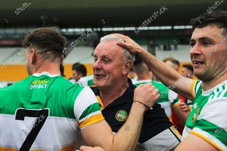 Offaly vs Fermanagh. Offaly's Jordan Hayes, Cian Farrell's grandfather Phillip Farrell and Ruairí McNamee celebrate after the game