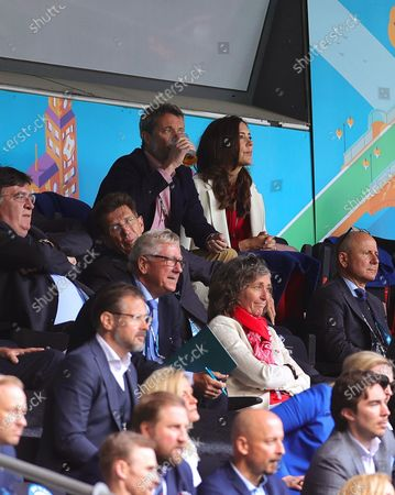 Crown Prince Frederik (C-L) and Crown Princess Mary (C-R) of Denmark attend the UEFA EURO 2020 group B preliminary round soccer match between Denmark and Finland in Copenhagen, Denmark, 12 June 2021.