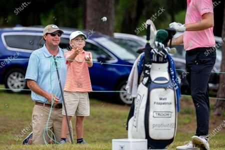 Matt Fitzpatrick, of England, tosses a ball to a fan on the first tee during the third round of the Palmetto Championship golf tournament in Ridgeland, S.C