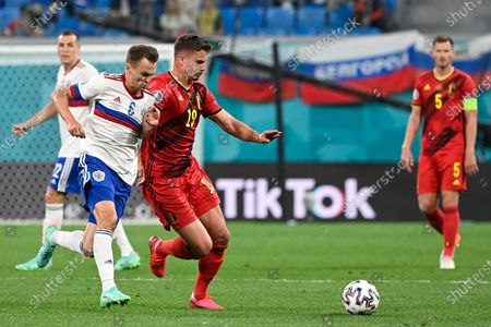 Russian Denis Cheryshev and Belgium's Leander Dendoncker fight for the ball during a soccer game between Russia and Belgium's Red Devils, the first game in the group stage (group B) of the 2020 UEFA European Football Championship, on Saturday 12 June 2021 in Saint Petersburg, Russia.