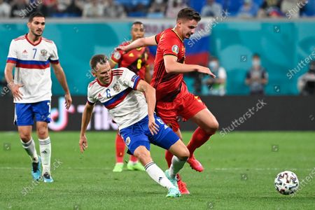 Russian Magomed Ozdoyev, Russian Denis Cheryshev and Belgium's Leander Dendoncker fight for the ball during a soccer game between Russia and Belgium's Red Devils, the first game in the group stage (group B) of the 2020 UEFA European Football Championship, on Saturday 12 June 2021 in Saint Petersburg, Russia.