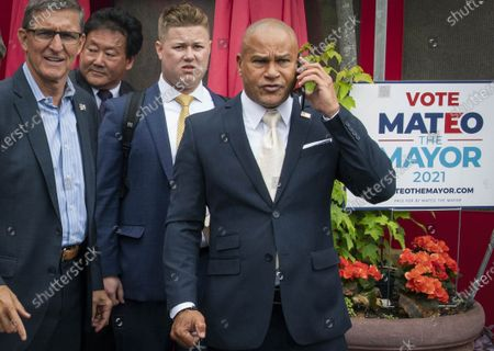 This photo from, shows Republican mayoral candidate Fernando Mateo, far right, with supporters including Michael Flynn, far left, former national security adviser, leaving a campaign in Staten Island, N.Y. Candidates in New York City's mayoral primary urged people to go to the polls in the coming days as early voting kicked off today