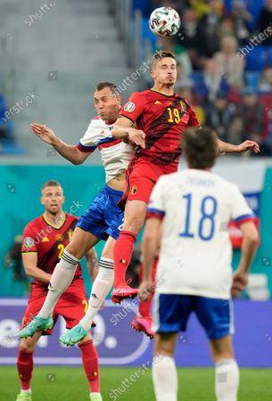 Russia's Artem Dzyuba, left, challenges Belgium's Leander Dendoncker during the Euro 2020 soccer championship group B match between Russia and Belgium at the Saint Petersburg stadium in St. Petersburg, Russia