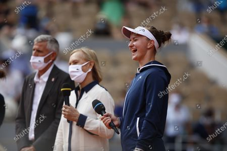 President of the French Tennis Federation (FFT) and former player Gilles Moretton (L) and former tennis player Martina Navratilova (R) congratulate Czech Republic's Barbora Krejcikova (C) as she receives the Suzanne Lenglen Cup after winning the women's singles final tennis match against Russia's Anastasia Pavlyuchenkova during the trophy ceremony on Day 14 of The Roland Garros 2021 French Open tennis tournament in Paris on June 12, 2021.  (Photo by Mehdi Taamallah/NurPhoto)