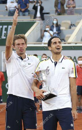 Winners Nicolas Mahut and Pierre-Hughes Herbert of France