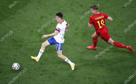 Leander Dendoncker (R) of Belgium in action against Aleksandr Golovin (L) of Russia during the UEFA EURO 2020 group B preliminary round soccer match between  Belgium and Russia in St.Petersburg, Russia, 12 June 2021.