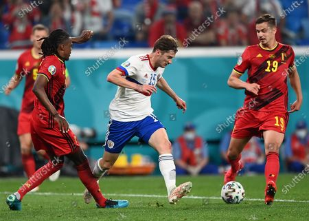 Aleksei Miranchuk of Russia (C) in action against Leander Dendoncker of Belgium (R) during the UEFA EURO 2020 group B preliminary round soccer match between  Belgium and Russia in St.Petersburg, Russia, 12 June 2021.