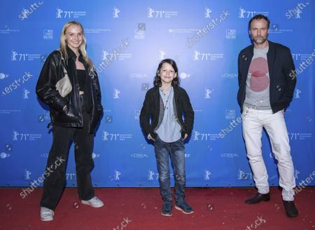 """German actress Jule Hermann, from left, and actor Wanja Valentin Kube pose together with actor Mark Waschke before the screening of the film """"Human Factors"""" in the """"Panorama"""" section as part of the film festival """"Berlinale Summer Special"""" at the outdoor cinema in the Kreuzberg district of Berlin, Germany"""