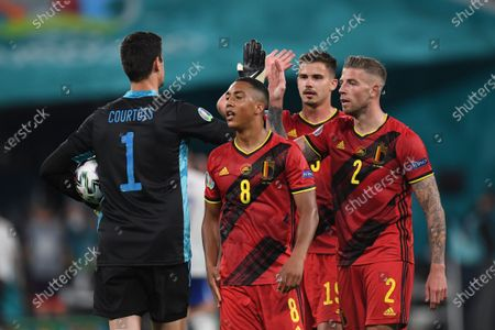 Belgium's goalkeeper Thibaut Courtois, left, Youri Tielemans, center, Leander Dendoncker, second right, and Toby Alderweireld, right, react after the Euro 2020 soccer championship group B match between Russia and Belgium at Gazprom arena stadium in St. Petersburg, Russia