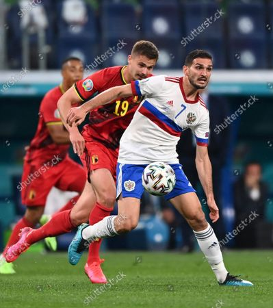 Russia's Magomed Ozdoyev, right, and Belgium's Leander Dendoncker challenge for the ball during the Euro 2020 soccer championship group B match between Russia and Belgium at Gazprom arena stadium in St. Petersburg, Russia