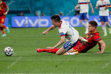 Russia's Aleksandr Golovin, left, and Belgium's Leander Dendoncker compete for the ball during the Euro 2020 soccer championship group B match between Belgium and Russia at the Saint Petersburg stadium in St. Petersburg, Russia