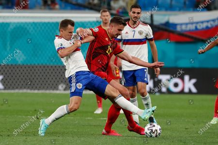 Russia's Denis Cheryshev, and Belgium's Leander Dendoncker compete for the ball during the Euro 2020 soccer championship group B match between Belgium and Russia at the Saint Petersburg stadium in St. Petersburg, Russia