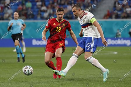 Belgium's Leander Dendoncker, left, and Russia's Artem Dzyuba vie for the ball during the Euro 2020 soccer championship group B match between Belgium and Russia at the Saint Petersburg stadium in St. Petersburg, Russia