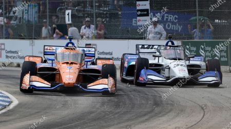 Stock Picture of Scott Dixon (9), of New Zealand, races Takuma Sato (30), of Japan, during the first race of the IndyCar Detroit Grand Prix auto racing doubleheader on Belle Isle in Detroit