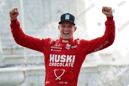 Marcus Ericsson, of Sweden, celebrates winning the first race of the IndyCar Detroit Grand Prix auto racing doubleheader on Belle Isle in Detroit