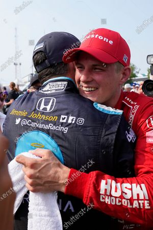 Marcus Ericsson, of Sweden, celebrates with Jimmie Johnson after winning the first race of the IndyCar Detroit Grand Prix auto racing doubleheader on Belle Isle in Detroit