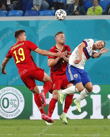 Dmitri Barinov (R) of Russia in action against Belgian players Toby Alderweireld (C) and Leander Dendoncker (L) during the UEFA EURO 2020 group B preliminary round soccer match between  Belgium and Russia in St.Petersburg, Russia, 12 June 2021.