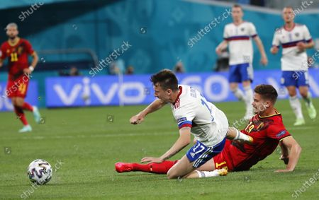 Aleksandr Golovin (C) of Russia in action against Leander Dendoncker (R) of Belgium during the UEFA EURO 2020 group B preliminary round soccer match between  Belgium and Russia in St.Petersburg, Russia, 12 June 2021.
