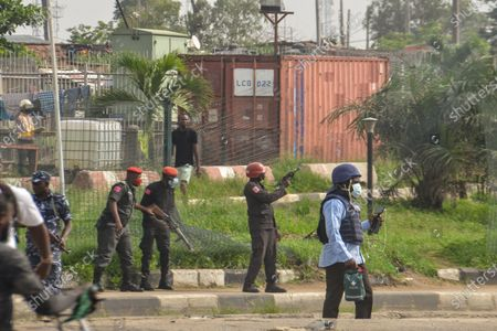 Policemen fire a tear gas canister at protesters during civil demonstration at the Gani Fahweyinmi Park, Ojota district of Lagos, Nigeria, venue of the June 12 protest, on 12 June 2021.Nigerian police on June 12, 2021 fired tear gas to disperse anti-government protesters in Lagos and the capital, Abuja, arresting many while others were injured. Many activists had called for nationwide protests on Saturday on June 12 'Democracy Day', which marks Nigeria's move to civilian rule more than 20 years ago, over what they criticise as bad governance and insecurity, as well as the recent #Twitter ban by the current government of President Muhammadu Buhari.