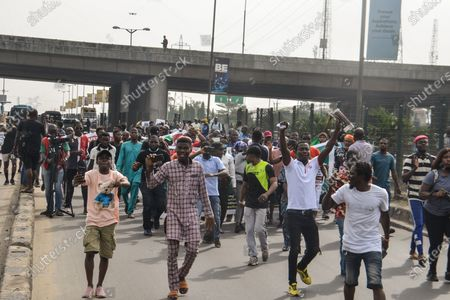Protesters eco slogans during civil demonstration at the Gani Fahweyinmi Park, Ojota district of Lagos, Nigeria, venue of the June 12 protest, on 12 June 2021.Nigerian police on June 12, 2021 fired tear gas to disperse anti-government protesters in Lagos and the capital, Abuja, arresting many while others were injured. Many activists had called for nationwide protests on Saturday on June 12 'Democracy Day', which marks Nigeria's move to civilian rule more than 20 years ago, over what they criticise as bad governance and insecurity, as well as the recent #Twitter ban by the current government of President Muhammadu Buhari.