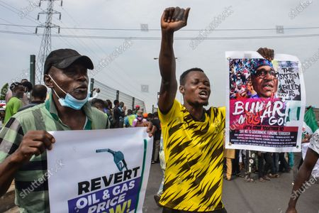 Protesters hold banners during civil demonstration at the Gani Fahweyinmi Park, Ojota district of Lagos, Nigeria, venue of the June 12 protest, on 12 June 2021.Nigerian police on June 12, 2021 fired tear gas to disperse anti-government protesters in Lagos and the capital, Abuja, arresting many while others were injured. Many activists had called for nationwide protests on Saturday on June 12 'Democracy Day', which marks Nigeria's move to civilian rule more than 20 years ago, over what they criticise as bad governance and insecurity, as well as the recent #Twitter ban by the current government of President Muhammadu Buhari.