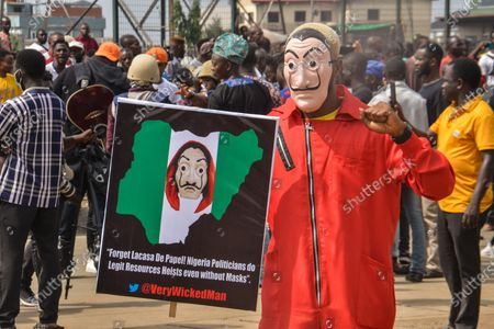 A protester holding a banner wears a mask during civil demonstration at the Gani Fahweyinmi Park, Ojota district of Lagos, Nigeria, venue of the June 12 protest, on 12 June 2021.Nigerian police on June 12, 2021 fired tear gas to disperse anti-government protesters in Lagos and the capital, Abuja, arresting many while others were injured. Many activists had called for nationwide protests on Saturday on June 12 'Democracy Day', which marks Nigeria's move to civilian rule more than 20 years ago, over what they criticise as bad governance and insecurity, as well as the recent #Twitter ban by the current government of President Muhammadu Buhari.