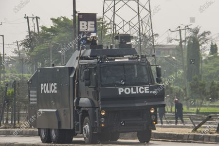 Stock Picture of A anti-riot police van waiting for detained protesters protester during civil demonstration at the Gani Fahweyinmi Park, Ojota district of Lagos, Nigeria, venue of the June 12 protest, on 12 June 2021.Nigerian police on June 12, 2021 fired tear gas to disperse anti-government protesters in Lagos and the capital, Abuja, arresting many while others were injured. Many activists had called for nationwide protests on Saturday on June 12 'Democracy Day', which marks Nigeria's move to civilian rule more than 20 years ago, over what they criticise as bad governance and insecurity, as well as the recent #Twitter ban by the current government of President Muhammadu Buhari.
