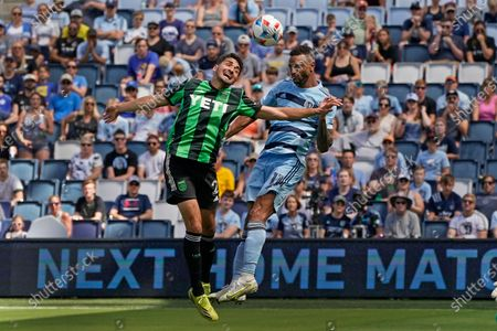 Austin FC midfielder Manny Perez, left, and Sporting Kansas City forward Khiry Shelton (11) battle for the ball during the second half of an MLS soccer match, in Kansas City, Kan. The match ended in a 1-1 tie