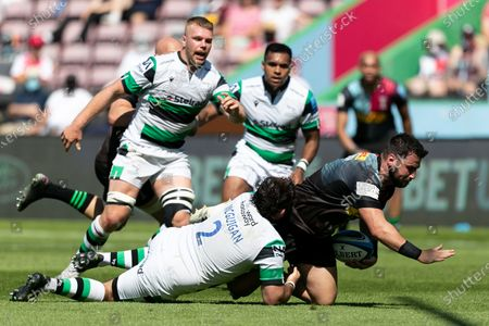 Stock Image of Scott Baldwin of Harlequins is tackled by George McGuigan of Newcastle Flacons during the Gallagher Premiership match between Harlequins and Newcastle Falcons at Twickenham Stoop, London, England on 12th June 2021.