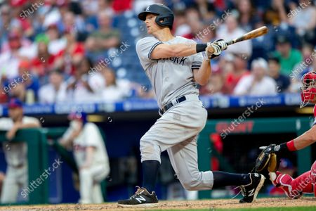 Stock Photo of New York Yankees' DJ LeMahieu (26) hits a three-run home run in the ninth inning of a baseball game against the Philadelphia Phillies, in Philadelphia