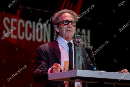 Stock Photo of Alfredo Castro receives the award for best supporting actor for his work in 'Kamawal' during the 24th edition of Malaga Film Festival, at Theater Cervantes in Malaga, Spain, 12 June 2021.