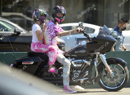Exclusive - Machine Gun Kelly seen on his motorcycle in Studio City with his daughter, Casie Colson Baker