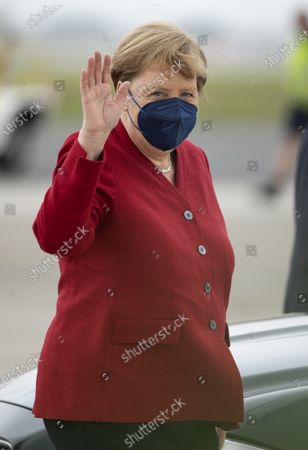Stock Photo of G7 Leaders' Airport Arrival - Chancellor of Germany Angela Merkel and her husband, Joachim Sauer