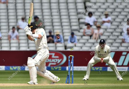 Stock Image of New Zealand's Will Young is bowled out by England's Olly Stone during the fourth day of the second cricket test match between England and New Zealand at Edgbaston in Birmingham, England