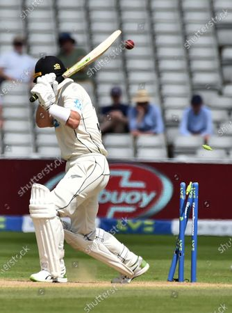 New Zealand's Will Young is bowled out by England's Olly Stone during the fourth day of the second cricket test match between England and New Zealand at Edgbaston in Birmingham, England