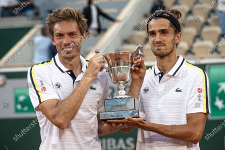 (210613) - PARIS, June 13, 2021 (Xinhua) - Pierre-Hugues Herbert (R) and Nicolas Mahut of France pose with the trophy after the men's doubles final match between Pierre-Hugues Herbert/Nicolas Mahut of France and Alexander Bublik/Andrey Golubev of Kazakhstan at the French Open tennis tournament at Roland Garros in Paris, France, June 12, 2021.