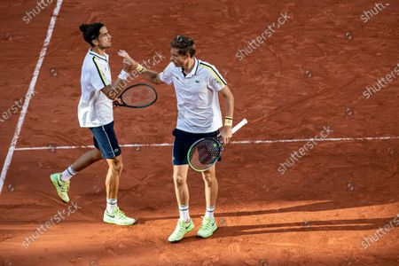 (210613) - PARIS, June 13, 2021 (Xinhua) - Pierre-Hugues Herbert (L) and Nicolas Mahut of France celebrate during the men's doubles final match between Pierre-Hugues Herbert/Nicolas Mahut of France and Alexander Bublik/Andrey Golubev of Kazakhstan at the French Open tennis tournament at Roland Garros in Paris, France, June 12, 2021.
