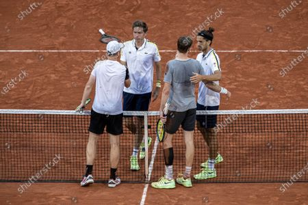(210613) - PARIS, June 13, 2021 (Xinhua) - Pierre-Hugues Herbert (1st R) and Nicolas Mahut (2nd L) of France shake hands with Alexander Bublik (2nd R) and Andrey Golubev of Kazakhstan after the men's doubles final match at the French Open tennis tournament at Roland Garros in Paris, France, June 12, 2021.