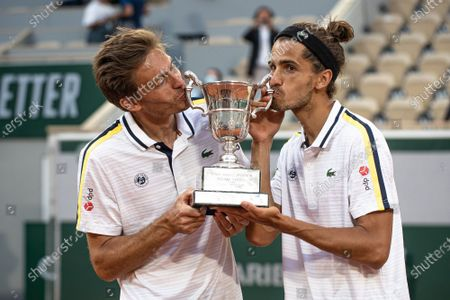 (210613) - PARIS, June 13, 2021 (Xinhua) - Pierre-Hugues Herbert (R) and Nicolas Mahut of France kiss the trophy after the men's doubles final match between Pierre-Hugues Herbert/Nicolas Mahut of France and Alexander Bublik/Andrey Golubev of Kazakhstan at the French Open tennis tournament at Roland Garros in Paris, France, June 12, 2021.