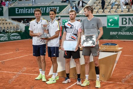 (210613) - PARIS, June 13, 2021 (Xinhua) - Pierre-Hugues Herbert (2nd L) and Nicolas Mahut (1st L) of France, Alexander Bublik (1st R) and Andrey Golubev of Kazakhstan awaits the awarding ceremony after the men's doubles final match at the French Open tennis tournament at Roland Garros in Paris, France, June 12, 2021.