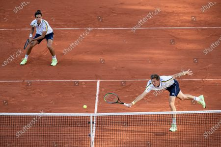 (210613) - PARIS, June 13, 2021 (Xinhua) - Pierre-Hugues Herbert (L) and Nicolas Mahut of France compete during the men's doubles final match between Pierre-Hugues Herbert/Nicolas Mahut of France and Alexander Bublik/Andrey Golubev of Kazakhstan at the French Open tennis tournament at Roland Garros in Paris, France, June 12, 2021.