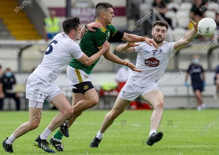 Stock Photo of Kildare vs Meath. Kildare's Kevin Flynn and David Hyland tackle Shane McEntee of Meath