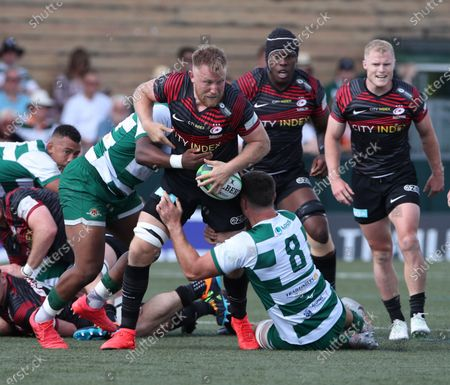 Jackson Wray of Saracens is tackled by Rayn Smid of Ealing