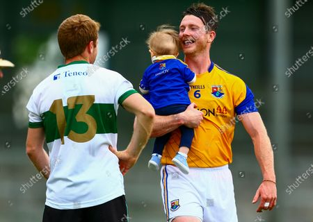 Longford vs Tipperary. Longford's Michael Quinn with his daughter Alice speaks to Brian Fox of Tipperary's at the end of the game