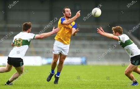 Stock Image of Longford vs Tipperary. Longford's David McGivney in action against Tipperary's James Feehan and Shane O'Connell