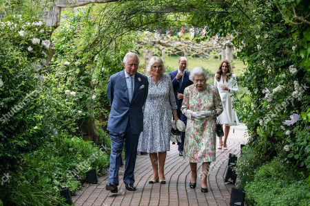 Stock Image of Britain's Queen Elizabeth II, centre, Prince Charles and Camilla, Camilla Duchess of Cornwall, Prince William and Kate, Catherine Duchess of Cambridge arrive at a reception for the G7 leaders at the Eden Project in Cornwall, England, during the G7 summit