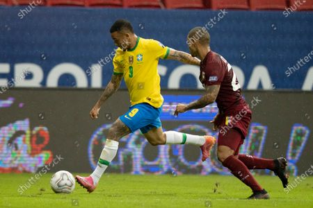 Gabriel Jesus of Brazil goes past Yohan Cumana of Venezuela; Mane Garrincha Stadium, Brasilia, Distrito Federal, Brazil; Copa America, Brazil versus Venezuela.
