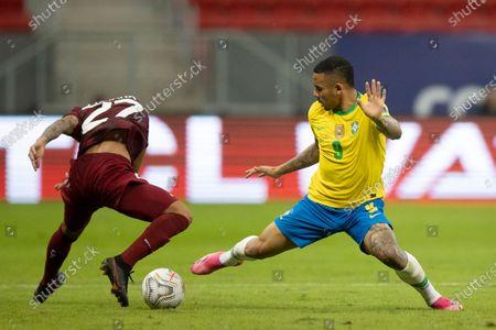 Gabriel Jesus of Brazil tackles Yohan Cumana of Venezuela; Mane Garrincha Stadium, Brasilia, Distrito Federal, Brazil; Copa America, Brazil versus Venezuela.